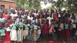 Exercise book distribution to orphans