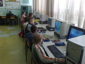 Students learning computer programs.