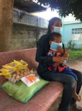 Mother and child collecting supplies