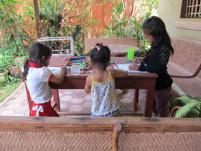 Kids play while mothers learn