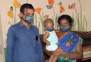 Nancy and her parents at Aravind Eye Hospital.