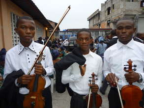 Three young violinists before the concert