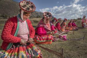 Sonia and Matilda prepare weavings for tourists.
