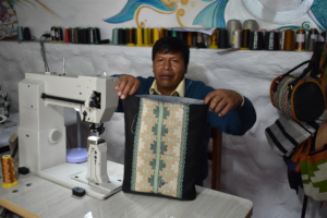 Sr.Tomas proudly shows us his sewing progress