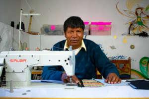 Senor Tomas sewing