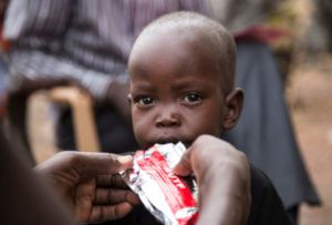 A child eats Plumpy'nut in South Sudan