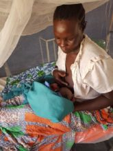 Sharah nurses her newborn son