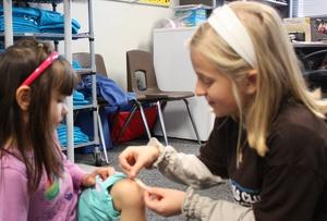 Aspiring pediatrician Nina helps a younger child