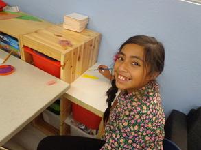 Jocelyn paints in the Oak View Branch Ed Room
