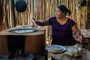 A woman from San Agustin using her new cookstove