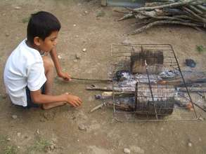 Child cooking over an open-flame