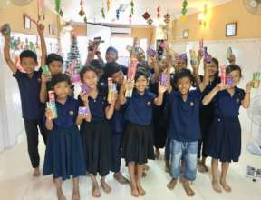 Children received toothpaste and brushes