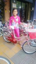 Rchana is very happy with her new bike.