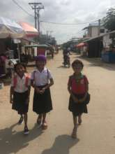 The girls are walking to school.
