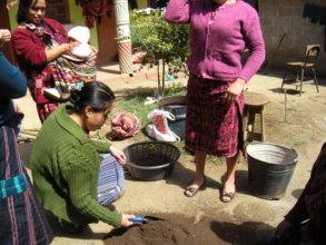Isabel preparing the soil for planting.