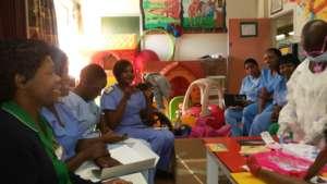 Rumbi taking nurses through a refresher course