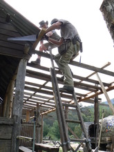 Volunteers Jamie and John working on the roof