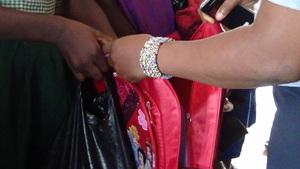 pupil recieving school bag