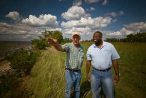 NRCS staff with Maryland farmer. USDA NRCS photo.