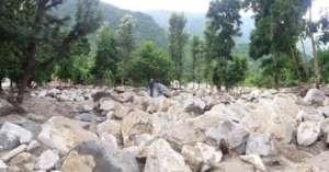 Landslide burying a village