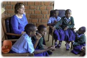 Linda with students in Tanzania