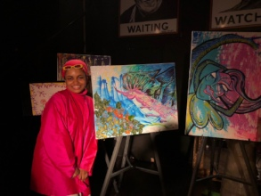 Joi, from our last newsletter, with her art!