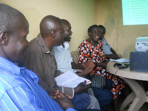Board members of the Centre briefing the students