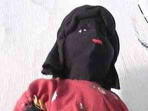 Textile dolls generating economic development