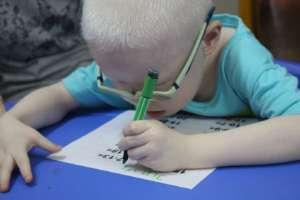 Hii is writing his name.