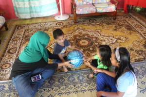 Hammad participating in group play