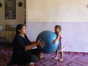 Gym ball is one of Maria's favourite toy.