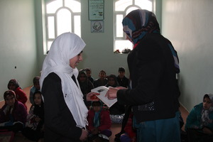 A teacher trained by AIL working with a student