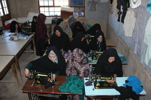 Students in an AIL sewing course