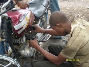 Abubakar Hassan learning to work on a cycle