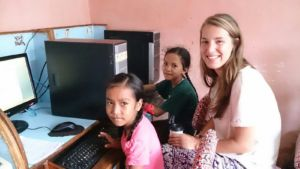Our volunteer, Sara, with the girls