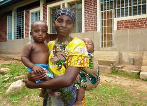 Tanzanian mother with her twin boys