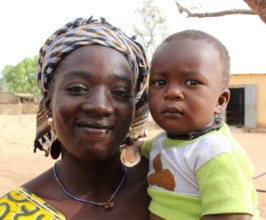 A mother smiles with her recently-vaccinated child