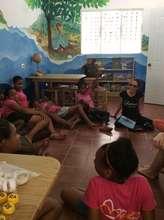 Julia Alvarez volunteering with girls in Library