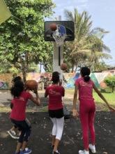Practicing basketball