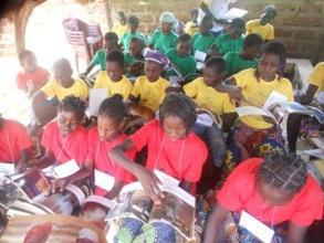 Kids Learning How to Care for a Book at 2012 Camp