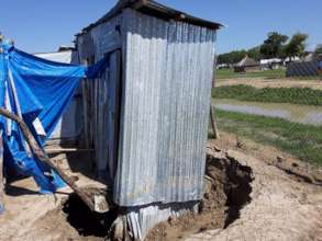 Collapsed latrine that will need to be rebuilt