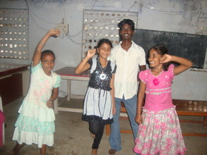 Murali dancing with other children