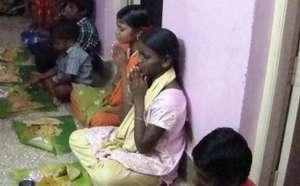 Valli praying before her meal