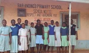 Bella (center) with primary school girls