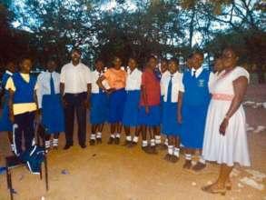 Mawego girls with Leonard, staff and Faith,teacher