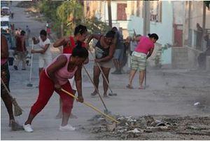 Residents of Santiago clear debris