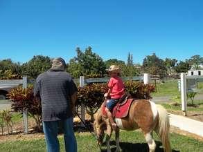 Having fun, riding a horse