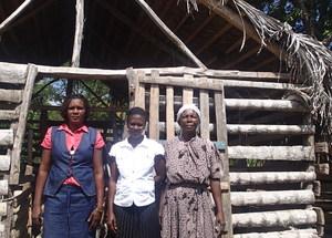 Members of OJF in front of a goat pen