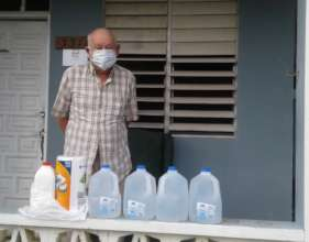 Participant with drinking water gallons