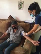Nurse with participant 2